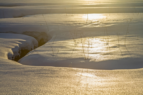 Sun reflecting on snow surface